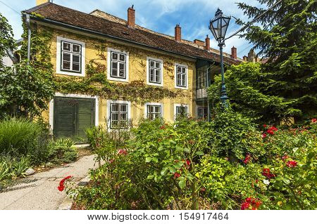 Old House With Flowers In Baden Bei Wien. Austria.