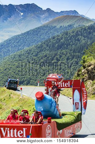 Col D'AspinFrance- July 15 2015: Vittel Caravan during the passing of the Publicity Caravan on the Col d'Aspin in Pyerenees Mountains in the stage 11 of Le Tour de France 2015. Vittel is a French bottled water brand.