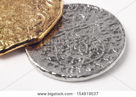Gold silver 19th century doubloons isolated on white. Pirate background