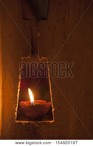 Diwali Festive of Lights. Close up view of a Diya, a clay oil lamp lite up.
