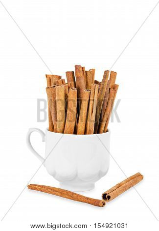 cinnamon stick in white cup isolated on white background Save clipping path.