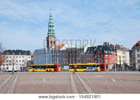 COPENHAGEN, DENMARK - APRIL 13, 2010: Transport near Slotsholmens Kanal (The Castle Islet Channel). On the background is Nikolaj Art Center (last Saint Nikolaj Church)