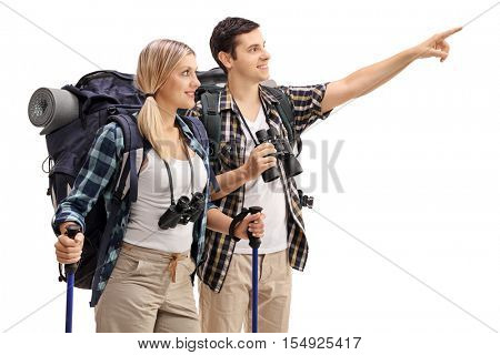 Male hiker showing something in the distance to a female hiker isolated on white background