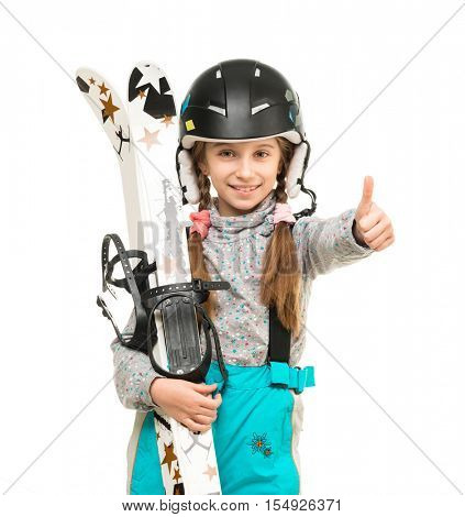 smiling little girl in helamet holding skis with thumb up isolated on white background