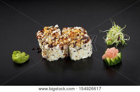 Delicious Sushi set. Uramaki sushi rolls decorated with sesame