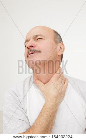 Man has sore throat infection and colds.
