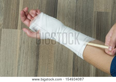 Woman Scratching With A Pen To Injured Wrist.
