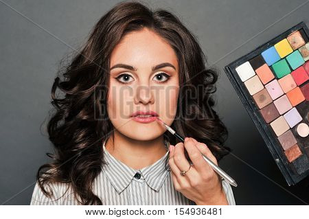 Makeup Artist Paints A Very Pretty Brunette