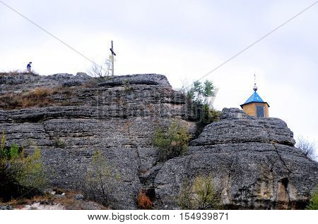 Ancient monastery. orthodox monastery Saharna Republic of Moldova. Chapel on top and wooden cross on a mountaintop