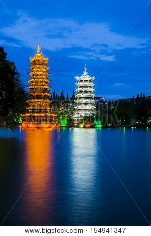 Sun and Moon Towers at a lake in Guildin, Guangxi Province, Peoples Republic of China