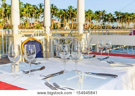 Festive Table In The Gazebo At Sunset