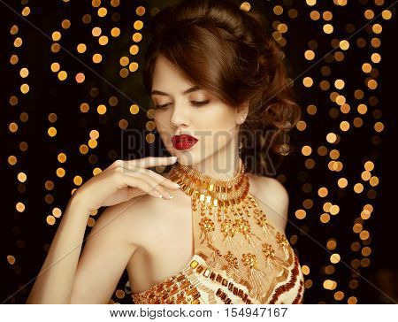 Makeup. Beautiful Young Woman In Fashion Golden Dress. Gorgeous Girl. Vogue Style. Elegant Lady On P