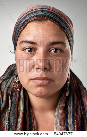 Portrait of real gypsy woman with no expression ID or passport photo full collection of diverse face and expressions