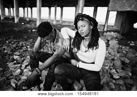 Couple of hip-hop afroamerican on undergraund. Black and white photo poster