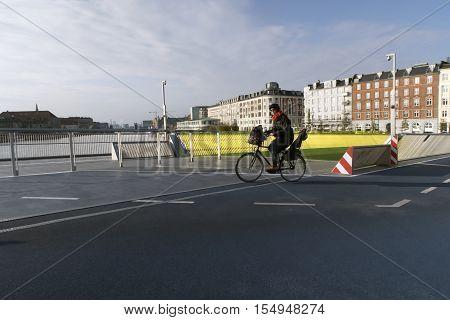 COPENHAGEN DENMARK - OCTOBER 24 2016: Cyclist on new Inner Harbour Bridge. It is a combined pedestrian and bicyclist bridge from Nyhavn to Christianshavn.