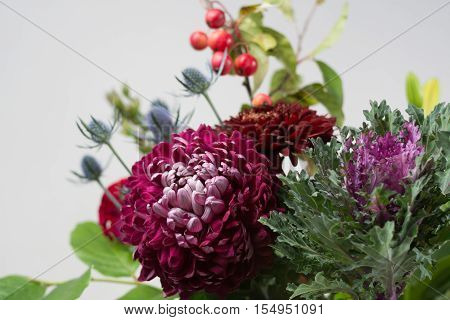 Colorful fresh flowers bouquet with dark chrysanthemum