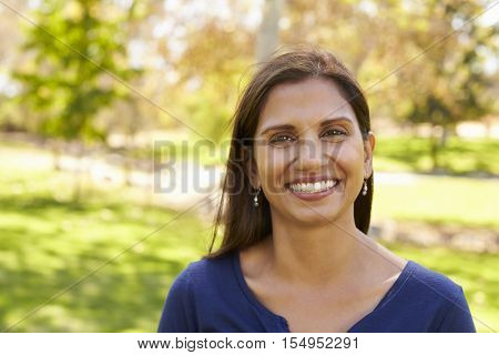 Mixed race Asian Caucasian woman in park looking to camera