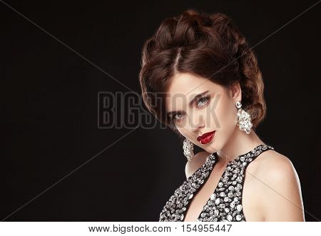 Fashion Jewelry. Woman Beauty Portrait. Elegant Hairstyle. Red Lips Makeup. Attractive Brunette In L