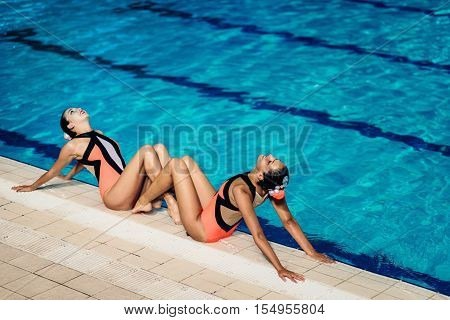 Synchronized Swimmers by the pool, toned image