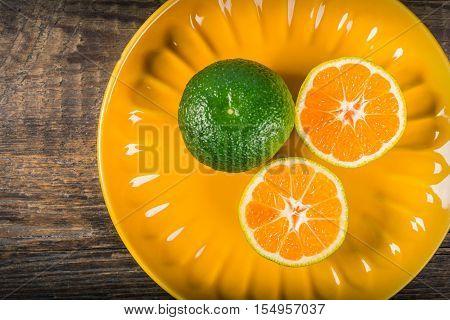 Sliced tangerines on ceramic plate. Natural vitamins