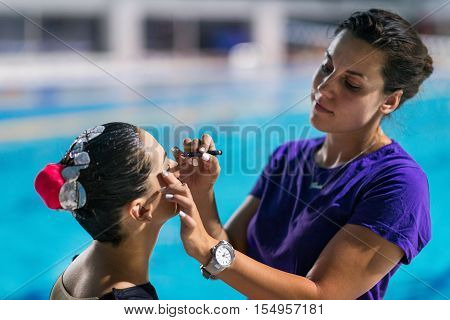 Applaying make up before competition on synchronized swimming competition