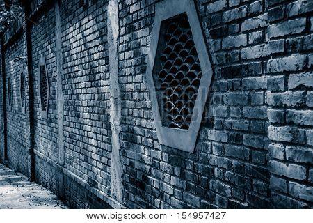 tradional brick window in chinese garden .