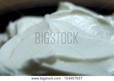 Closeup view of yogurt in a bowl.