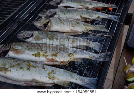 Grilling Whole Fishes On Grate In Garden. Grilled Marinated Fresh Trouts Over The Charcoals On Barbe
