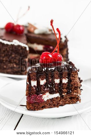 Chocolate Cake With Cherry On Wooden Background