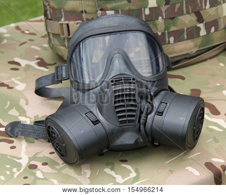 A Full Face Black Plastic Military Protective Gas Mask.