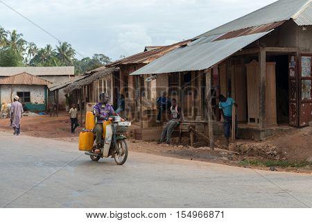 ZANZIBAR, TANZANIYA- JULY 16: man riding motorbike on Zanzibar village streeton July 16, 2016 in Zanzibar