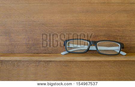 Hipster Glasses On Wood Shelf