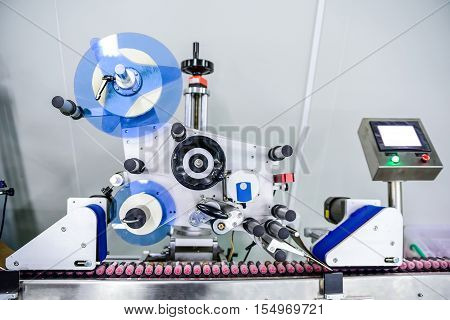 View on modern labeling machine at factory's workshop