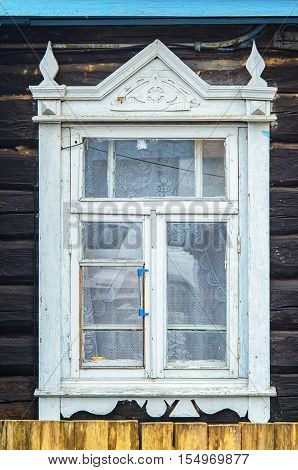 Wooden windows lacy architecture of old wooden houses. Wooden Architecture Facade Elements. Window