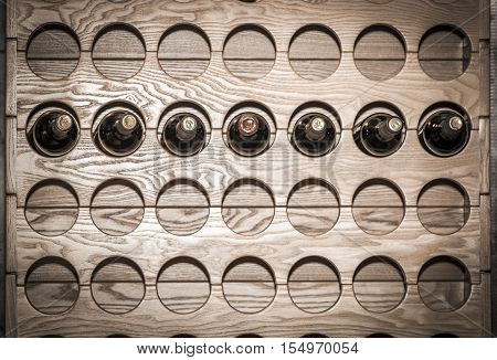 A wall mounted round wine rack in cellar