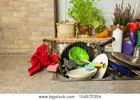 Dirty dishes in the sink after family celebrations. Home cleaning the kitchen. Cluttered dishes in the sink. Housework. poster