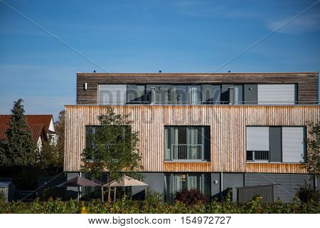 Modern house with wooden cladding - wooden facade wooden house