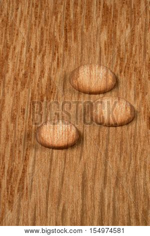 Three Water Droplets On Wooden Plank