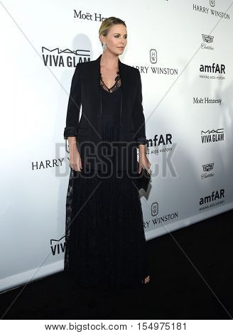 LOS ANGELES - OCT 27:  Charlize Theron arrives to the amFAR's Inspiration Gala on October 27, 2016 in Hollywood, CA
