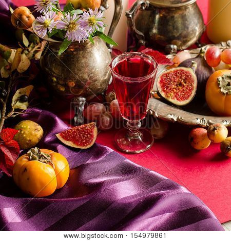 Autumn Still Life With Figs And Berry Infusion