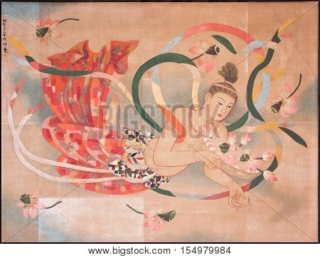 Tokyo Japan - September 26 2016: Sensual peach and red colored image of a floating half-naked woman painted on the ceiling of the main Honzo hall at Senso-ji Buddhist Temple.