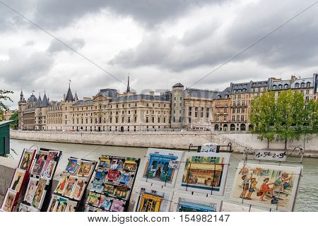 PARIS, FRANCE - april,23,  2016 Castle Conciergerie - former royal palace and prison. Conciergerie located on the west of the Cite Island  View from the other side of the river Seine