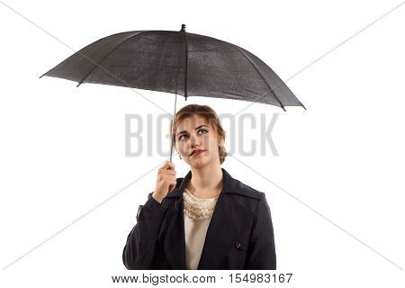 An elegant lady holding a black umbrella