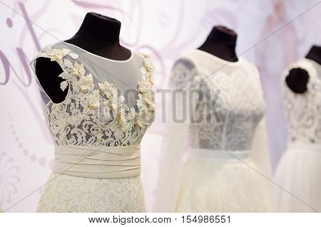 Beautiful wedding dresses on a mannequins on wedding fair