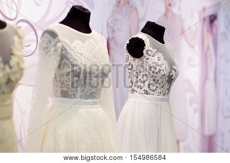 Beautiful wedding dresses on a mannequins on wedding fair
