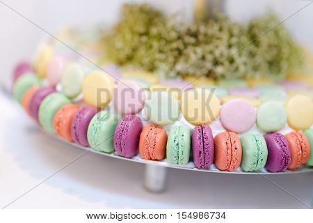 Traditional French Macarons On A Cake Stand