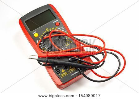 Digital multimeter with probes on a white background