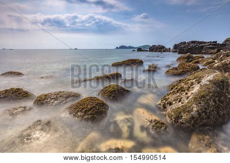 Landscape with Chagwido Island and strange volcanic rocks, view from Olle 12 corse in Jeju Island, South Korea.