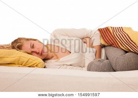 Woman Lying In Bed Holding Belly Because Of The Pain In Stomac.