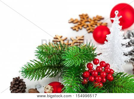Christmas firtree with new year decoration red balls greeting card pinecone. Isolated white background